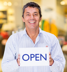 Palm Harbor Commercial Business Insurance - Business Owner with Open Sign