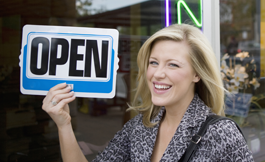 Dunedin Commercial Business Insurance - Business Owner Holding Open Sign